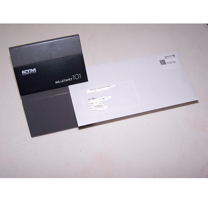 Büro - Bürowerkzeuge - Elektrischer Brieföffner mit Brief