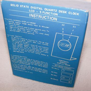Haushalt - Messen & Regeln - LCD Quarz-Tischuhr - Verpackungsrückseite