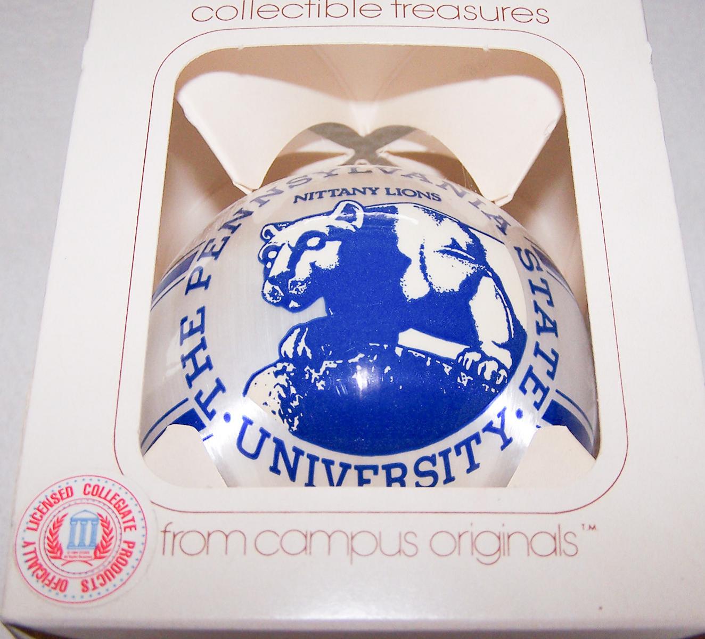 Souvenirs - Kunststoffkugel der Nittany Lions von der Pennsylvania State University - Frontansicht in Verpackung