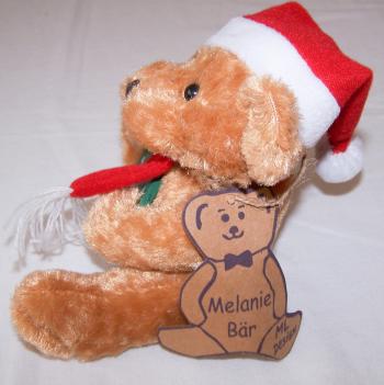 Haushalt - Dekoration - Bär mit Nikolausmütze vom Rüdesheimer Weihnachtsmarkt der Nationen - Seitenansicht